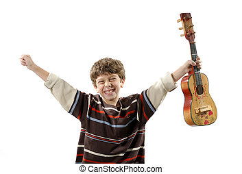 Photo of a Child Holding a Musical Instrument / Ukulele - Music Related