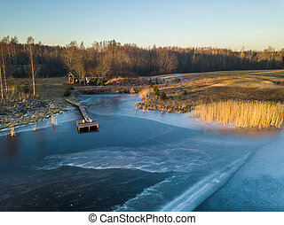 Photo of a Frozen Lake in an Autumn Day