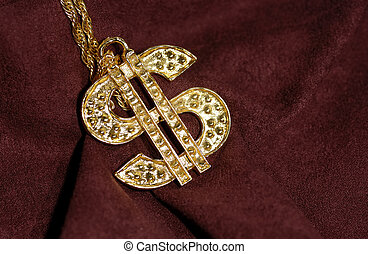 Photo of a Gold Dollar Symbol on a Burgundy Background - Bling / Wealth