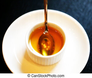 Photo of a macro cup with honey on the table