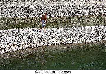 Photo Of A Man Diving Into The Water For A Swim