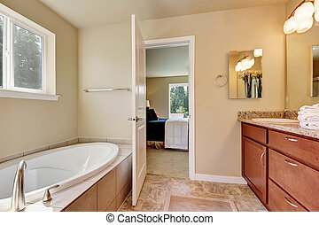 Photo of a mid-sized bathroom with wood cabinets, granite...