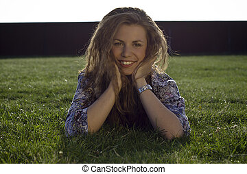 Pretty Blond Girl Lying On Grass