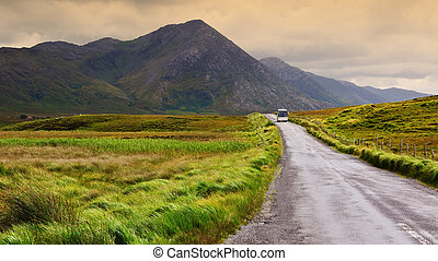 a scenic irish nature landscape with tourist bus - photo of...