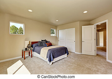 Photo of a small craftsman master bedroom with beige walls.