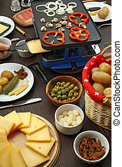 Raclette dinner - Photo of a table full of items for a...