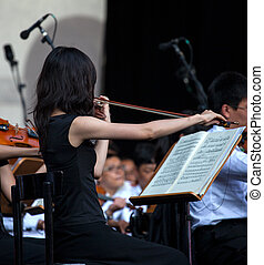 Photo of a Violinist with musical score in concert