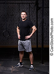 Photo of a young crossfit sportsman in sportwear while...