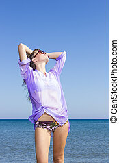 Photo of a young woman by the sea