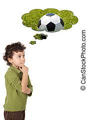 adorable boy thinking - photo of an adorable boy thinking a ...