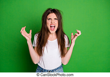 Photo of angry attractive girl wear white t-shirt have problem with hair arms look up isolated green color background