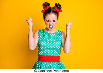 Photo of angry girl raise fists feel frustration wear teal clothes isolated over vivid color background