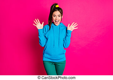 Photo of astonished person arms palms up open mouth good mood wear sweater isolated on pink color background