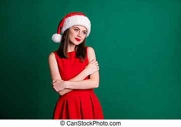 Photo of attractive cute lady model newyear party 2021 midnight hug herself watch fireworks magic wear santa cap red mini dress snow girl costume isolated green pastel dark color background