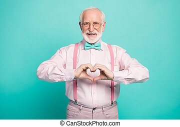 Photo of attractive grandpa making heart figure fingers hands inviting wife romance date wear specs pink shirt suspenders bow tie trousers isolated teal color background