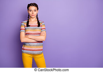 Photo of attractive lady holding arms crossed responsible strict chief watching, colleagues working wear casual striped t-shirt yellow trousers isolated purple color background