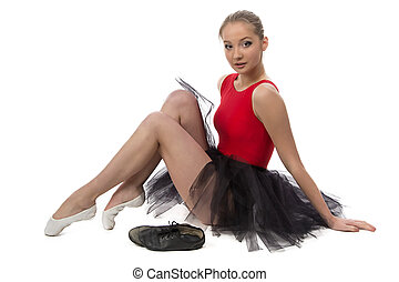 Photo of ballerina sitting on the floor