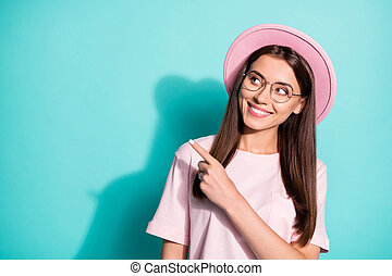 Photo of beaming lady girl wear pink vintage outfit headwear pointing empty space isolated teal color background