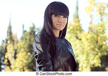 Photo of beautiful brunette woman is in modern style, glamur portrait
