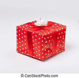photo of beautiful cute gift on the wonderful white studio background