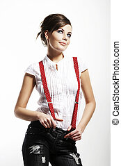 Photo of beautiful girl stretching suspenders on white...