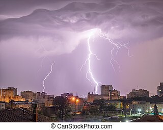 Photo of beautiful powerful lightning over big city, zipper and thunderstorm, abstract background, dark blue sky with bright electrical flash, thunder and thunderbolt.