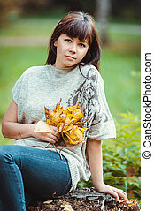 Photo of beautiful pretty brunette woman in park