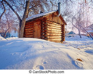 Photo of beautiful wooden outhouse with roof under the snow