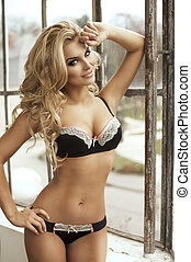 Photo of beautiful young blonde girl smiling, posing with...