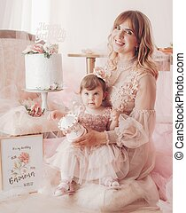 Photo of beautiful young blonde woman with little daughter celebrate her birthday