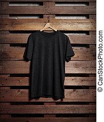 Photo of black tshirt holding on wood background - Photo of...