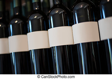 Photo of bottle of wine in a row