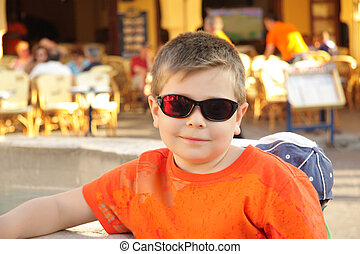 Photo of boy in sunglasses