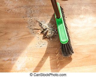 brush cleaning pile of debris