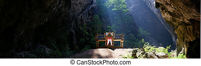 Photo of buddhist temple in mountain cave