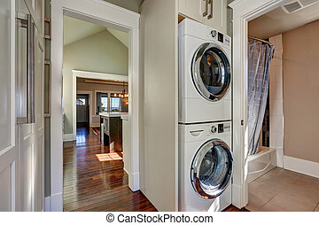 Photo of built-in laundry appliances in bathroom - Photo of...