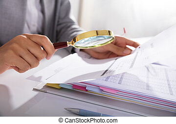 Businesswoman Analyzing Invoice