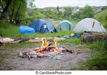 Photo of campground and campfire in forest