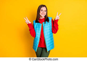 Photo of charming attractive girl have enjoy autumn fall holiday make v-sign wear season good look clothes pants isolated over shine color background