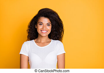 Photo of charming fascinating, cute girl standing confidently looking into camera near empty space isolated brigth color background
