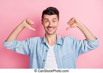 Photo of charming handsome young happy man point fingers himself me isolated on pastel pink color background