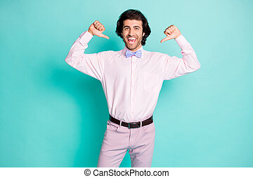 Photo of cheerful good mood wavy hair man wear pink outfit pointing himself two thumbs fingers isolated teal color background