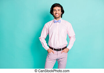 Photo of cheerful positive curly wavy hair fiance wear pink outfit hands arms pockets flowers isolated teal color background