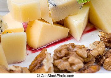 Photo of cheese pieces with walnuts