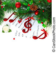 Photo of Christmastime treble clef, red musical symbol on note pages, festive holiday border, traditional Christmas carol, New Year tree decorated with different beautiful baubles, Xmas greeting card