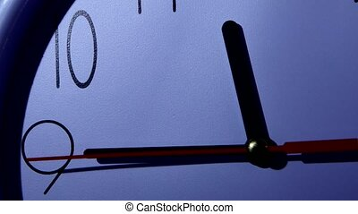Photo of clock showing several minutes to noon, night -...