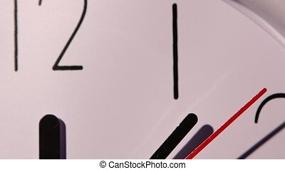 Photo of clock showing several minutes to noon. close up of...