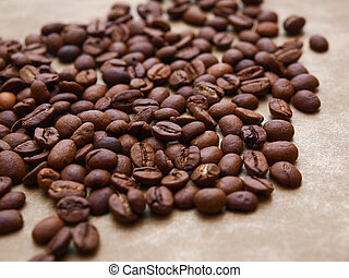 Photo of coffee beans on gold background