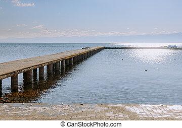 Concrete pier on big lake in Europe