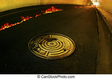 photo of concrete tunnel with fire and manhole